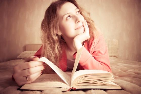 bigstock-girl-dreams-reading-the-book-15369656-2